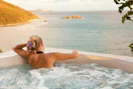 Woman relaxing in spa at Caribbean villa med